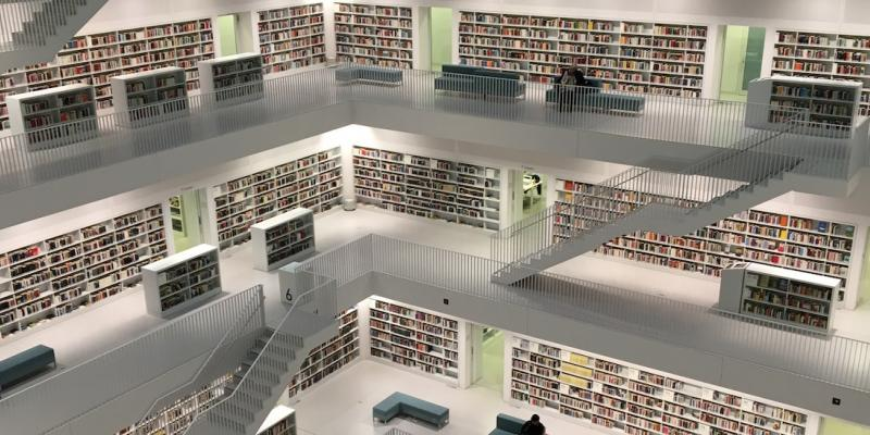 Three levels of a library with lots of books.