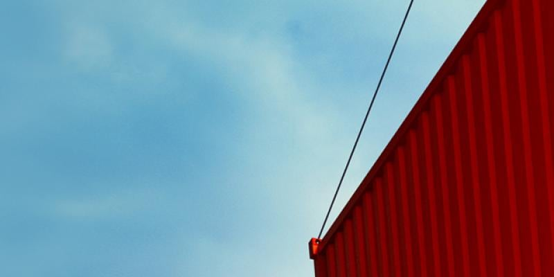 Orange container against a blue sky