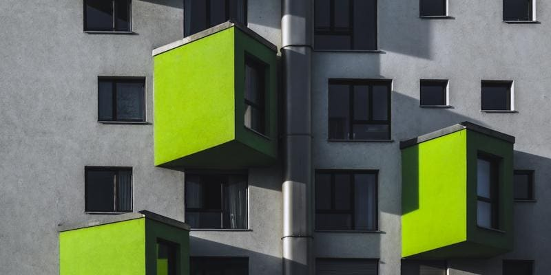 green paint on an apartment building