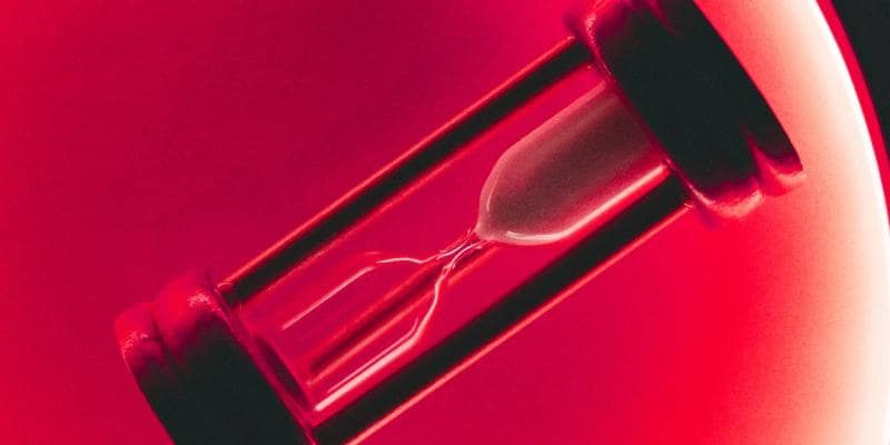 Small hourglass against a red background