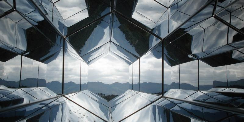 Mirrored Panels in a hexagonal shape looking out on mountains