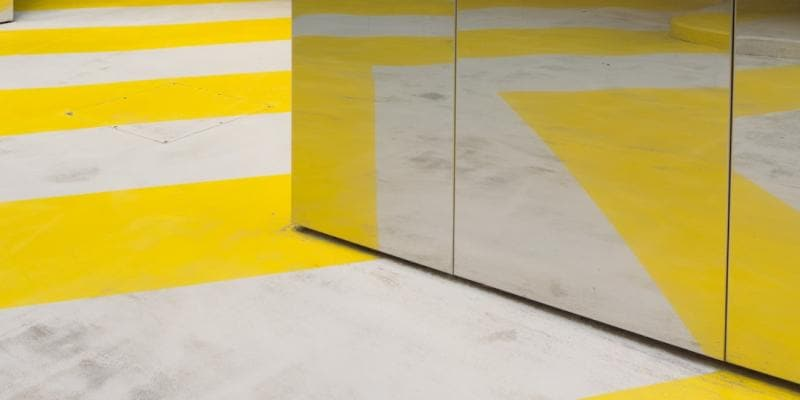 Yellow stripes on concrete