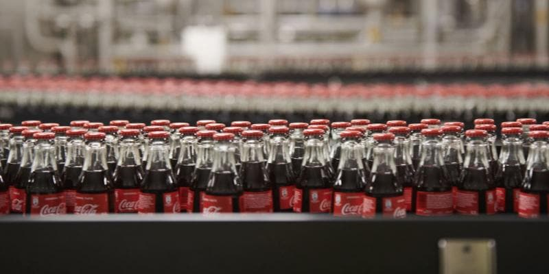 Coke bottles in a bottling plant