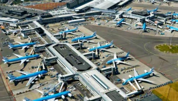 top view of parked planes on airport gates