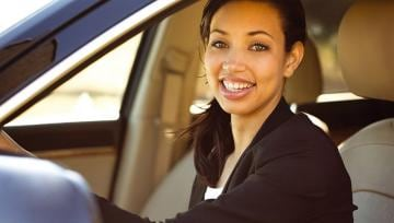 smiling woman in drivers seat