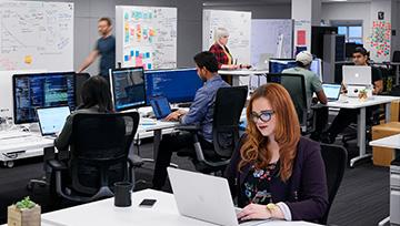 Young stylish employees working in modern office
