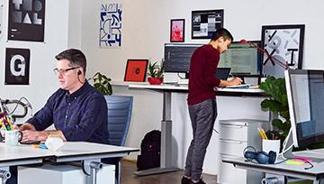 Two men working at stand-up desks
