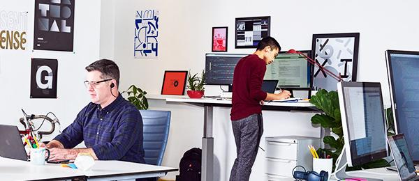 Two men in a technology-oriented office