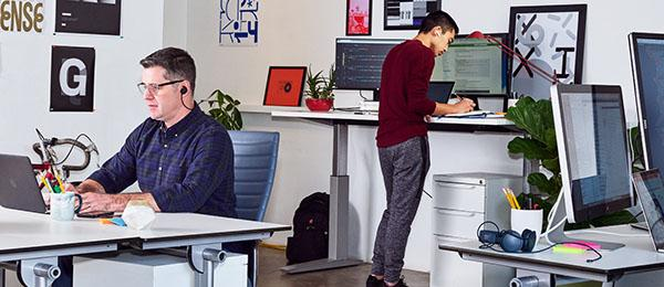 Two people working in an open office