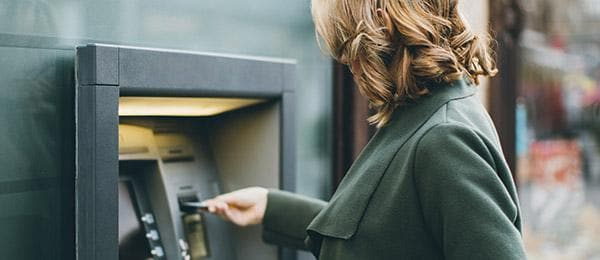 woman at an ATM machine