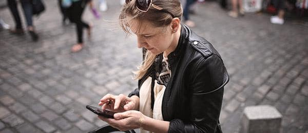 woman touching the screen on her smart phone