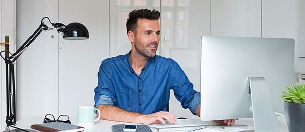 person working with desktop computer