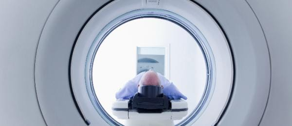 person going through a scan machine