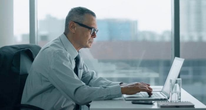 Image of a man using a laptop computer